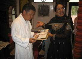 Showing Book to Takashi Okamura